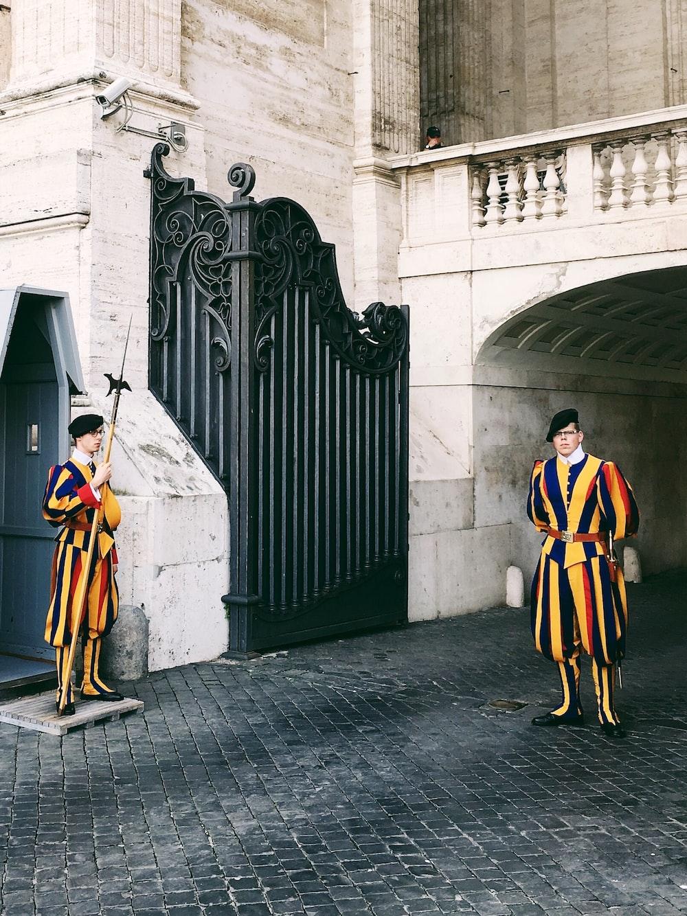 man standing near gate