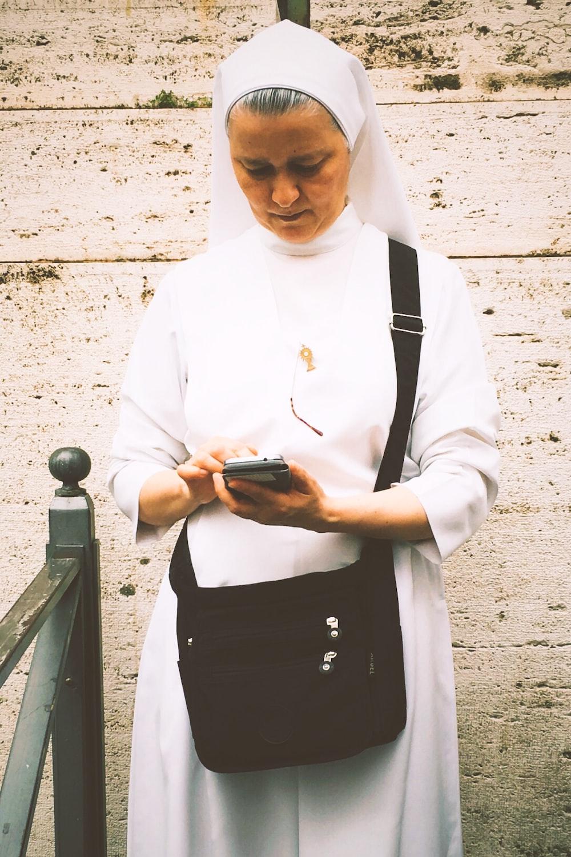 nun using smartphone