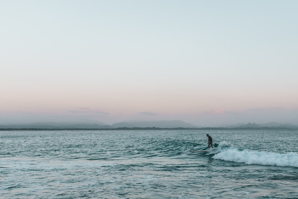 person surfing during golden hour