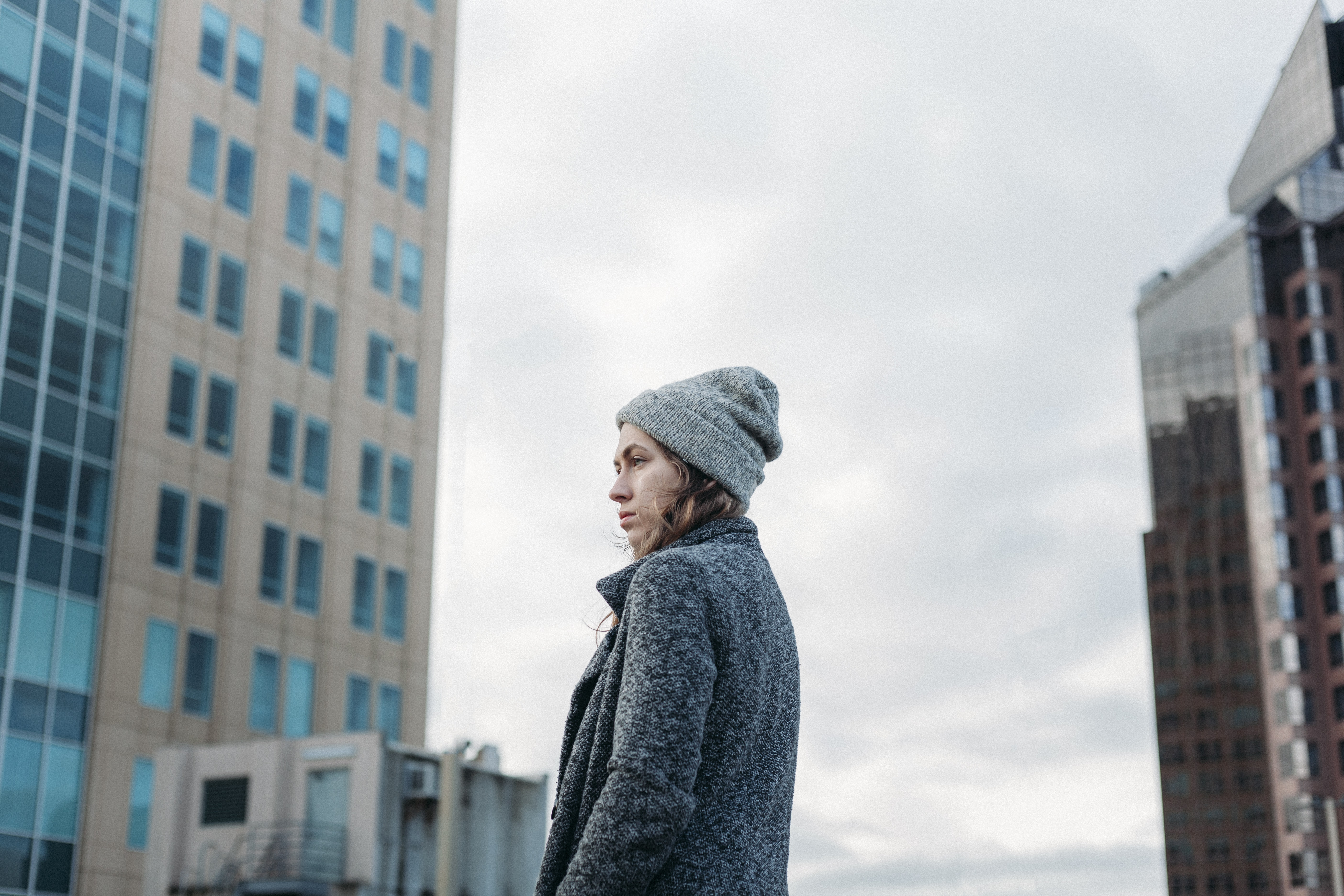 woman standing near the building during daytime