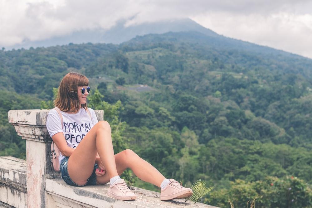 woman sitting on terrace