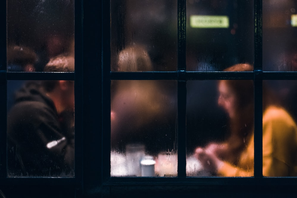 fogged window showing two person sitting