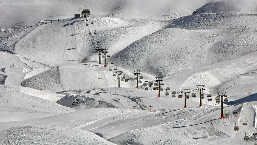 high-angle photography of cable cars near snow ground