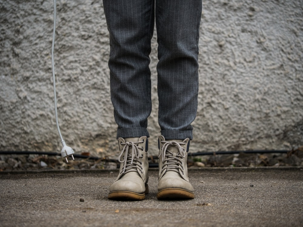 person wearing gray boots