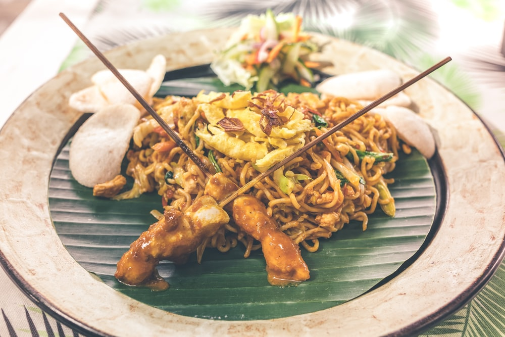 stir fry noodles and barbecue with side dish