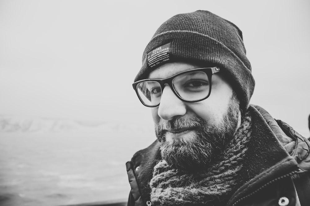 grayscale photo of man wearing knit cap
