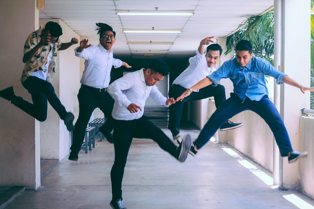 group of people doing jump shot photography