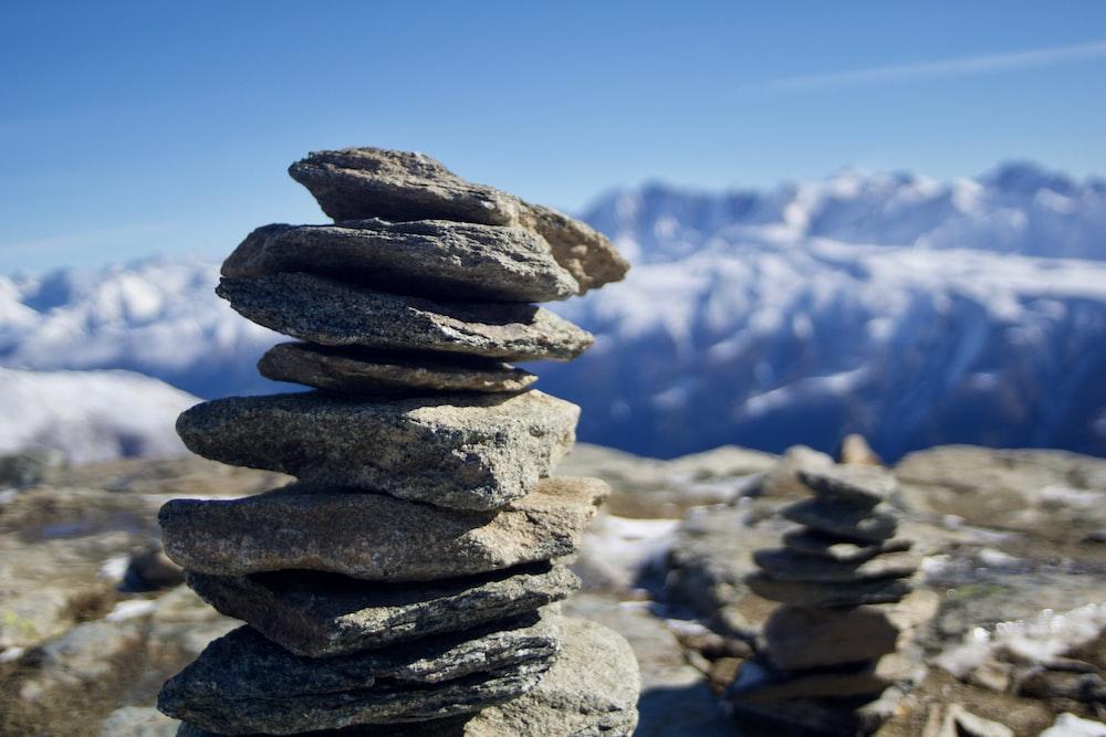 pile of rocks under blue sky at daytime