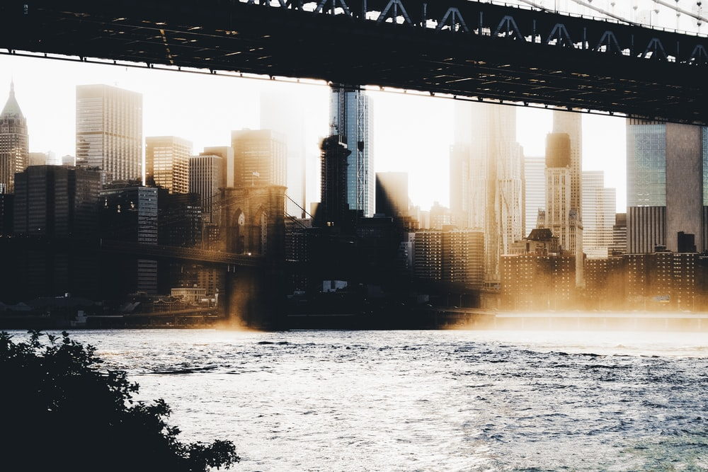 photography of high-rise buildings near body of water