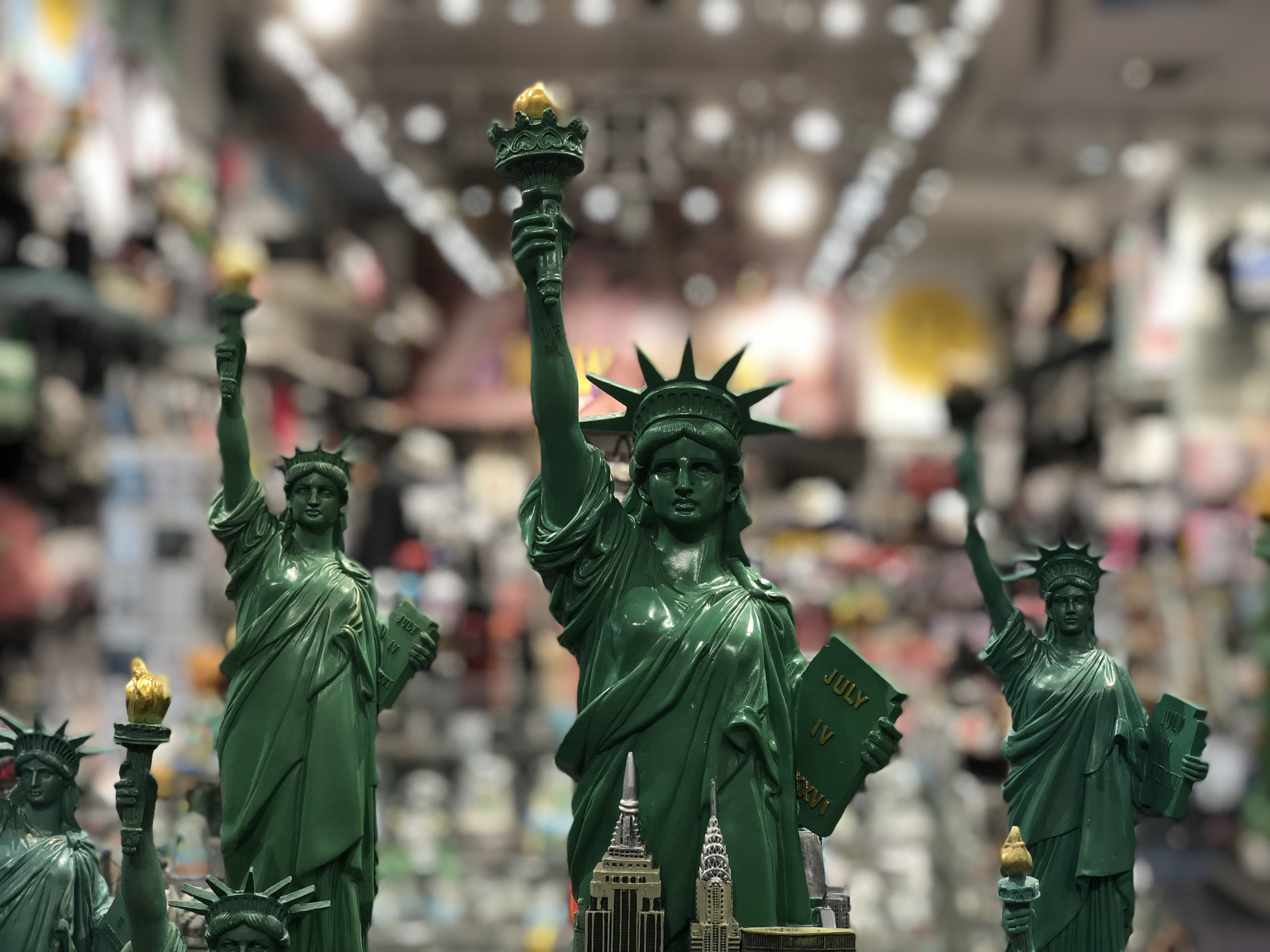 five green statue of liberty in shallow focus lens