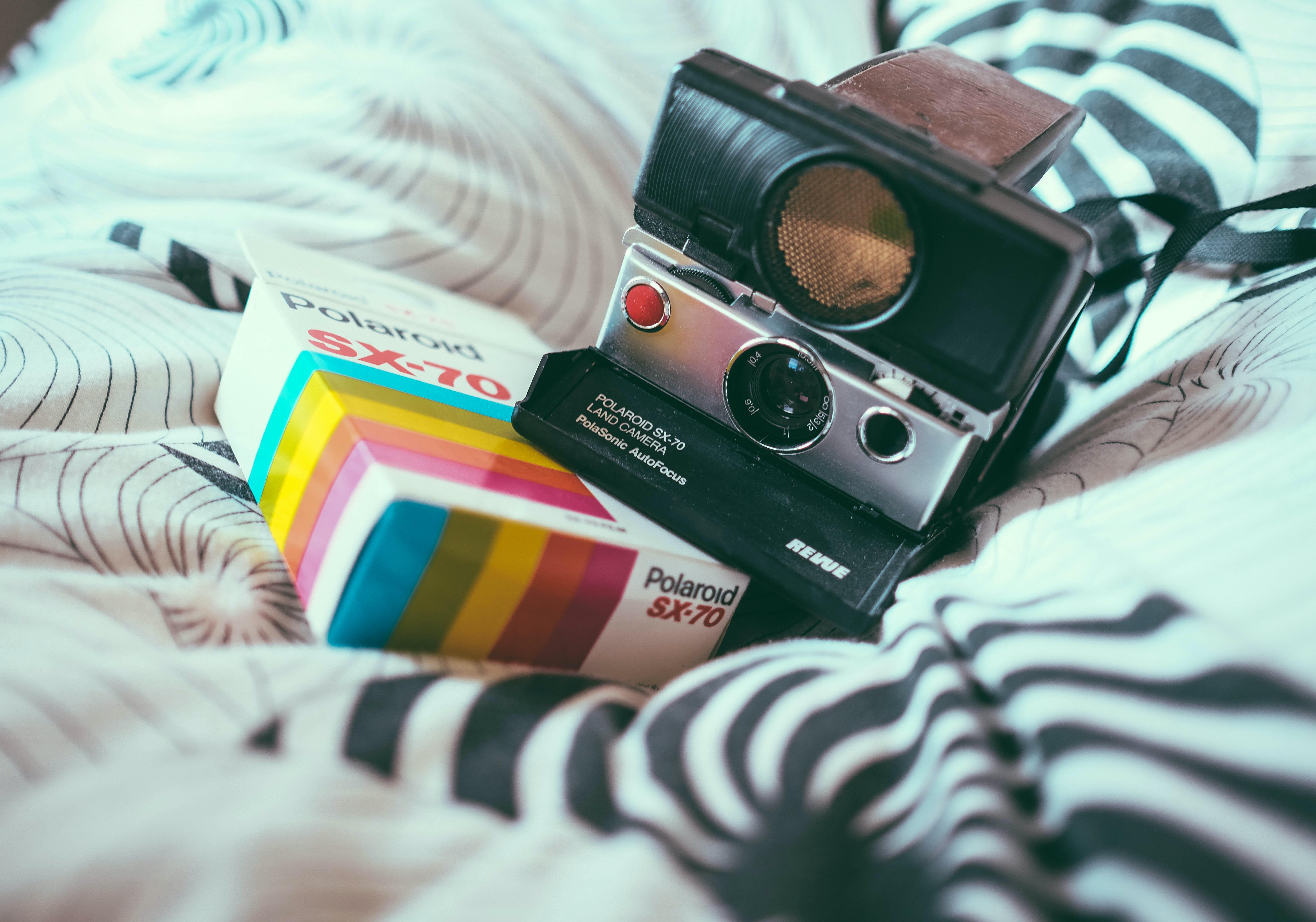 black and gray Polaroid land camera