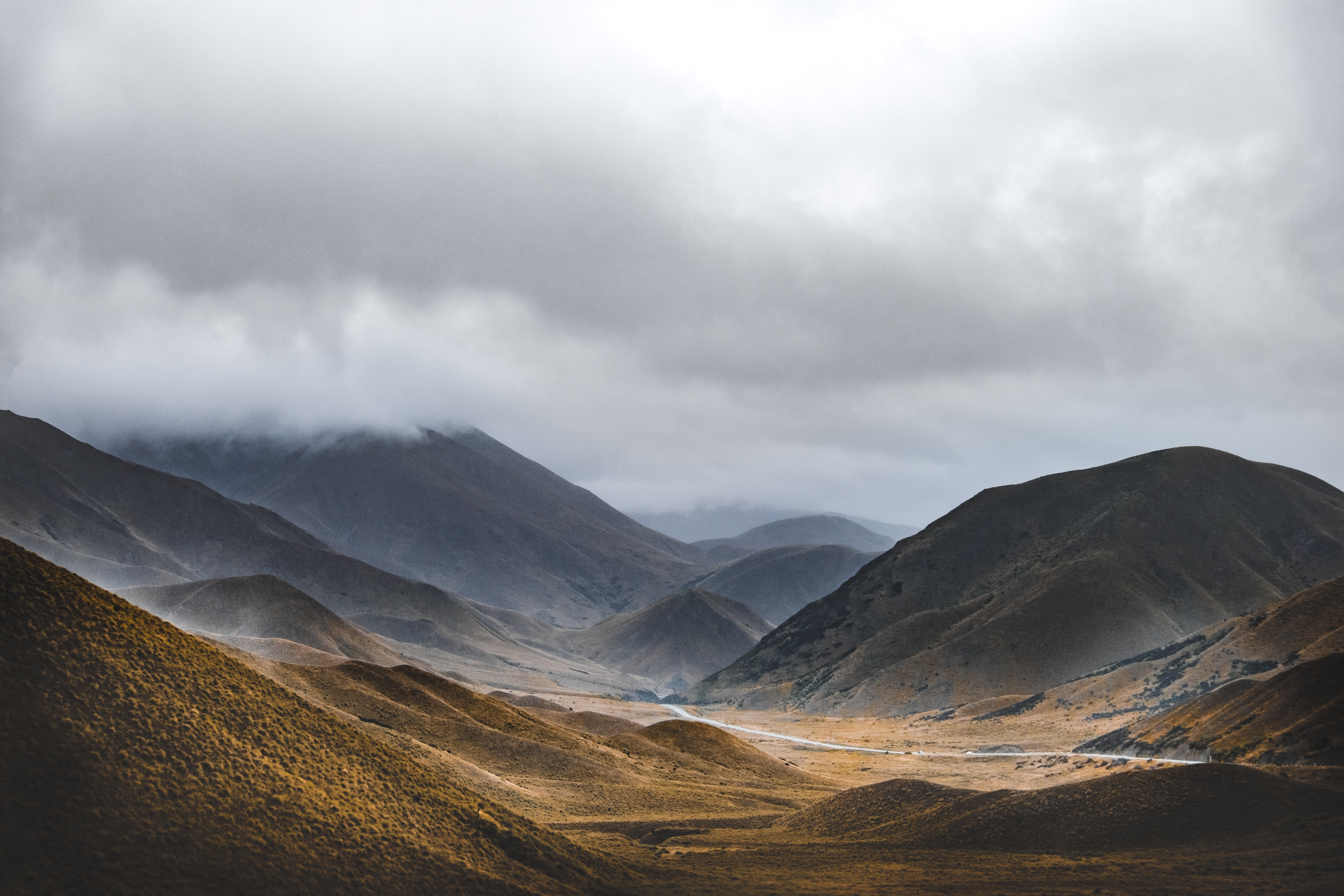 brown mountains under gray sky