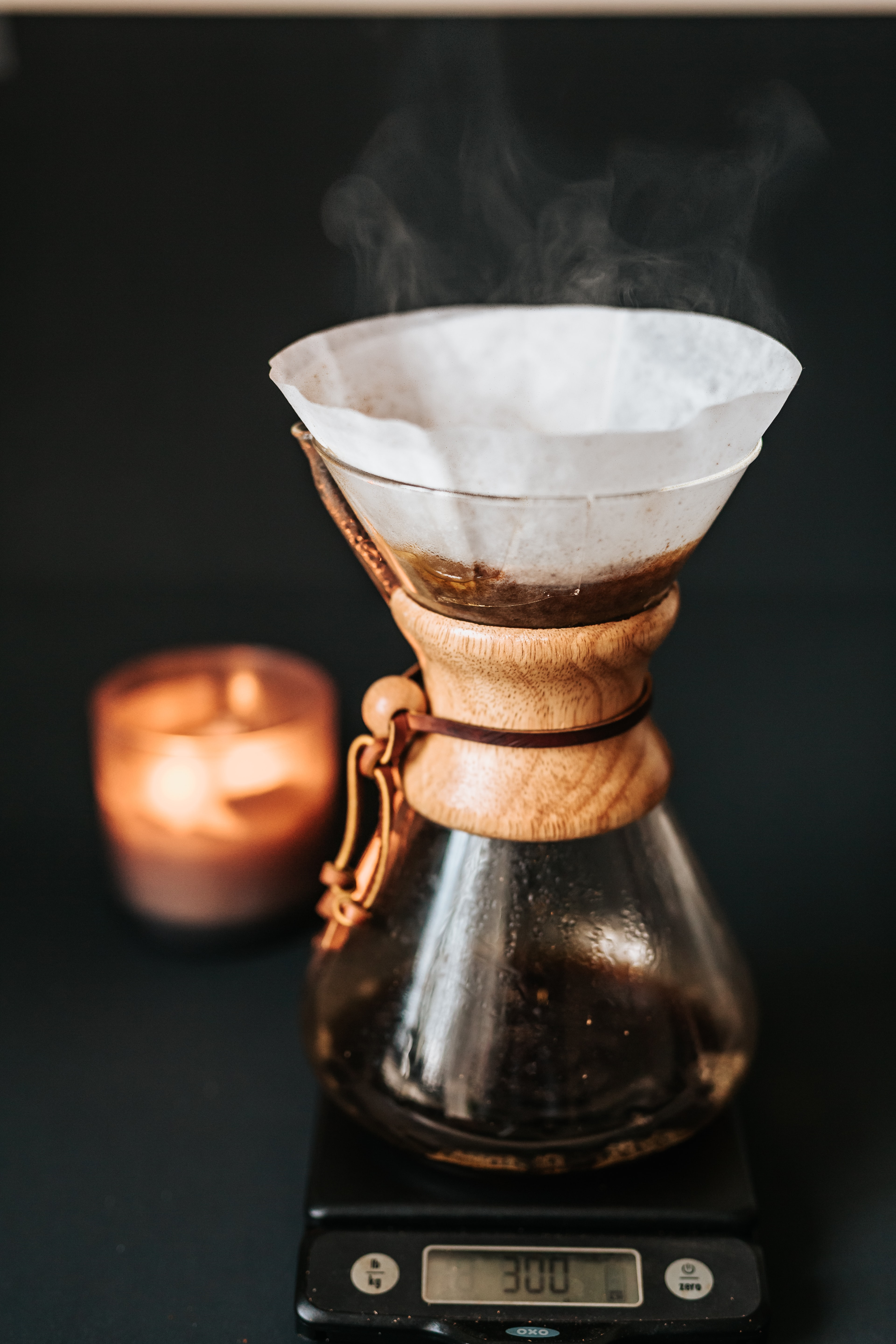 coffee in clear glass container on top of digital scale 300