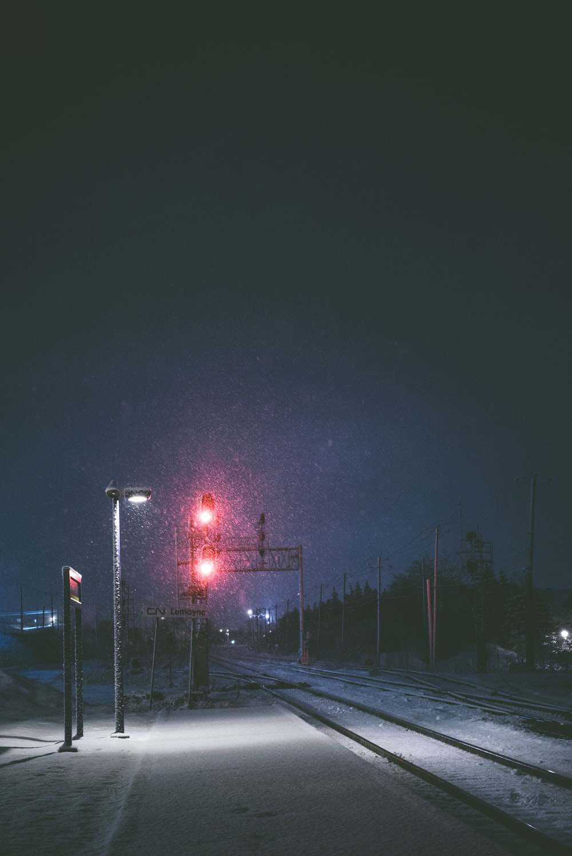 stop light on traffic light near rail road