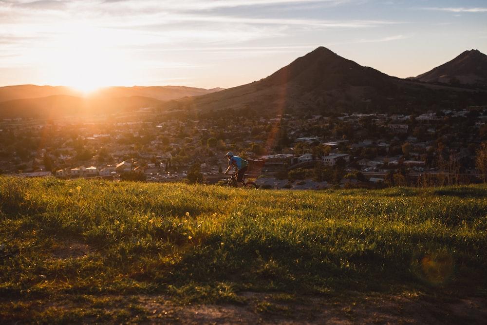man riding bicycle during sunset