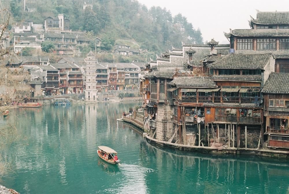 boat near wood building