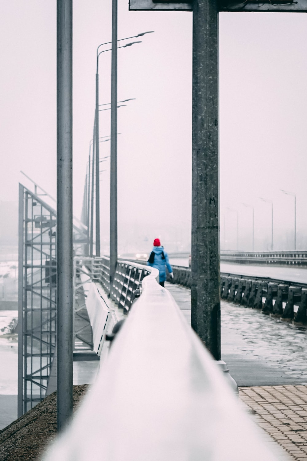 woman walking on bridge during winter
