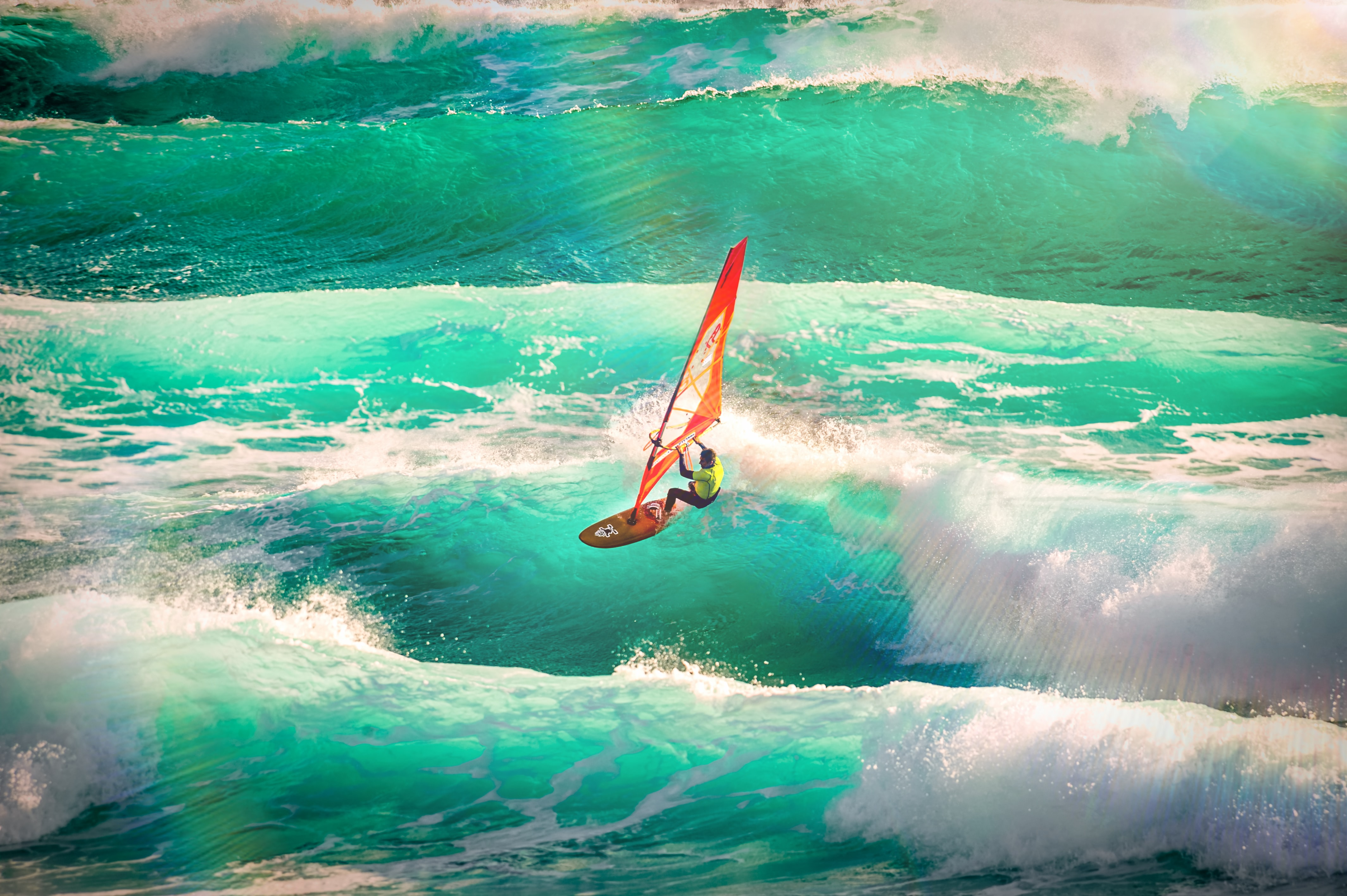 man using wind surfboard during daytime