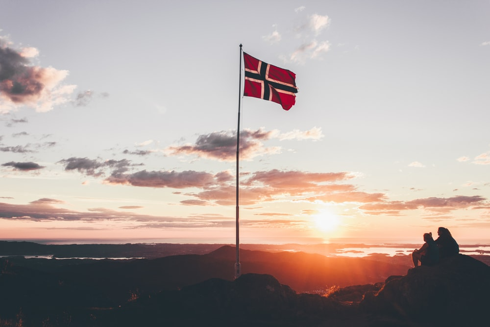 Norway flag standing on cliff