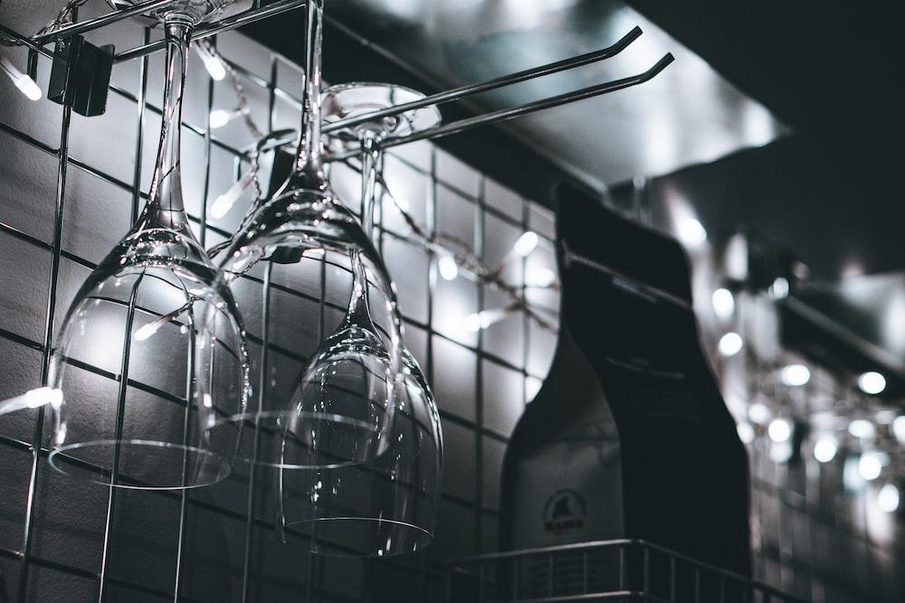 wine glasses hanging on rack