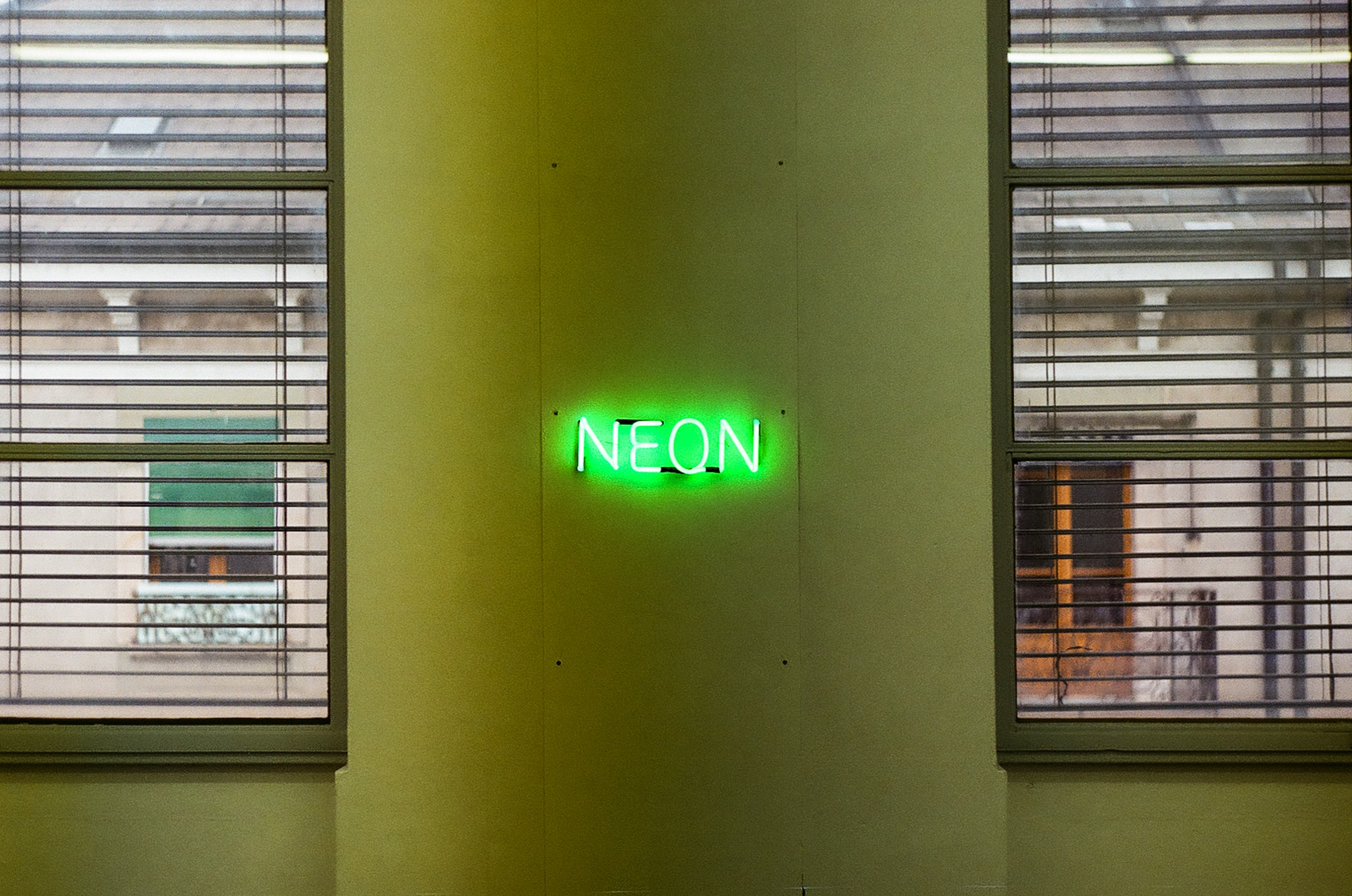 turned on neon signage on wall during daytime