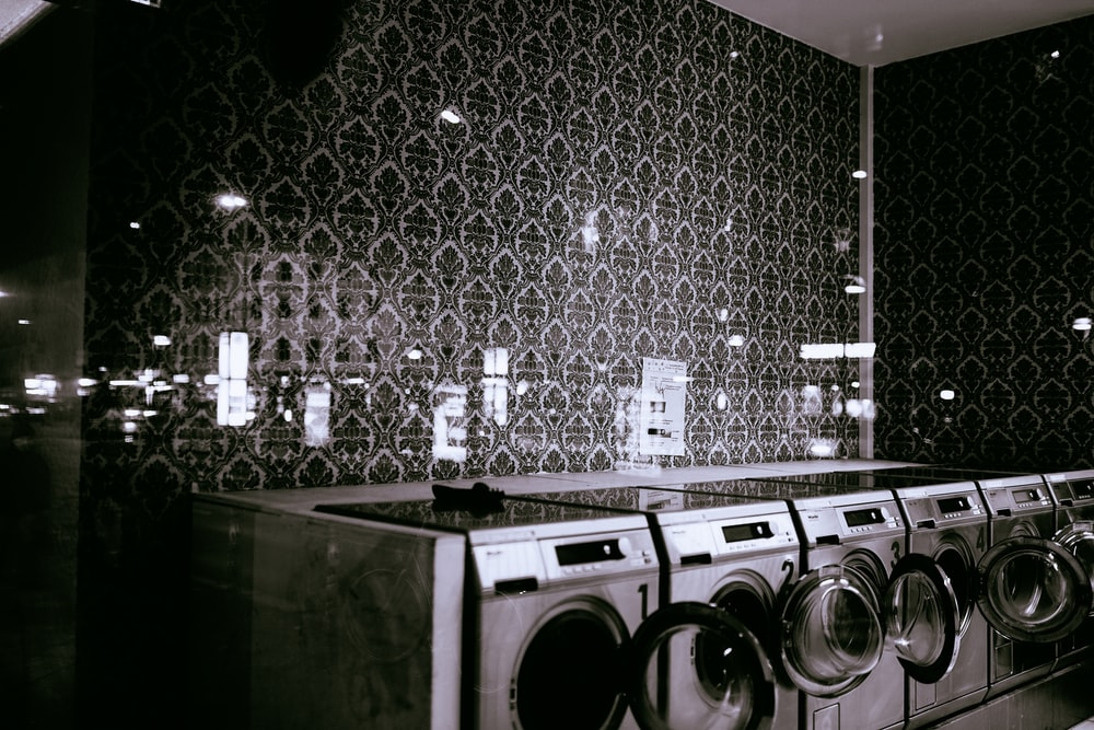 photography of gray washer and dryer during daytime