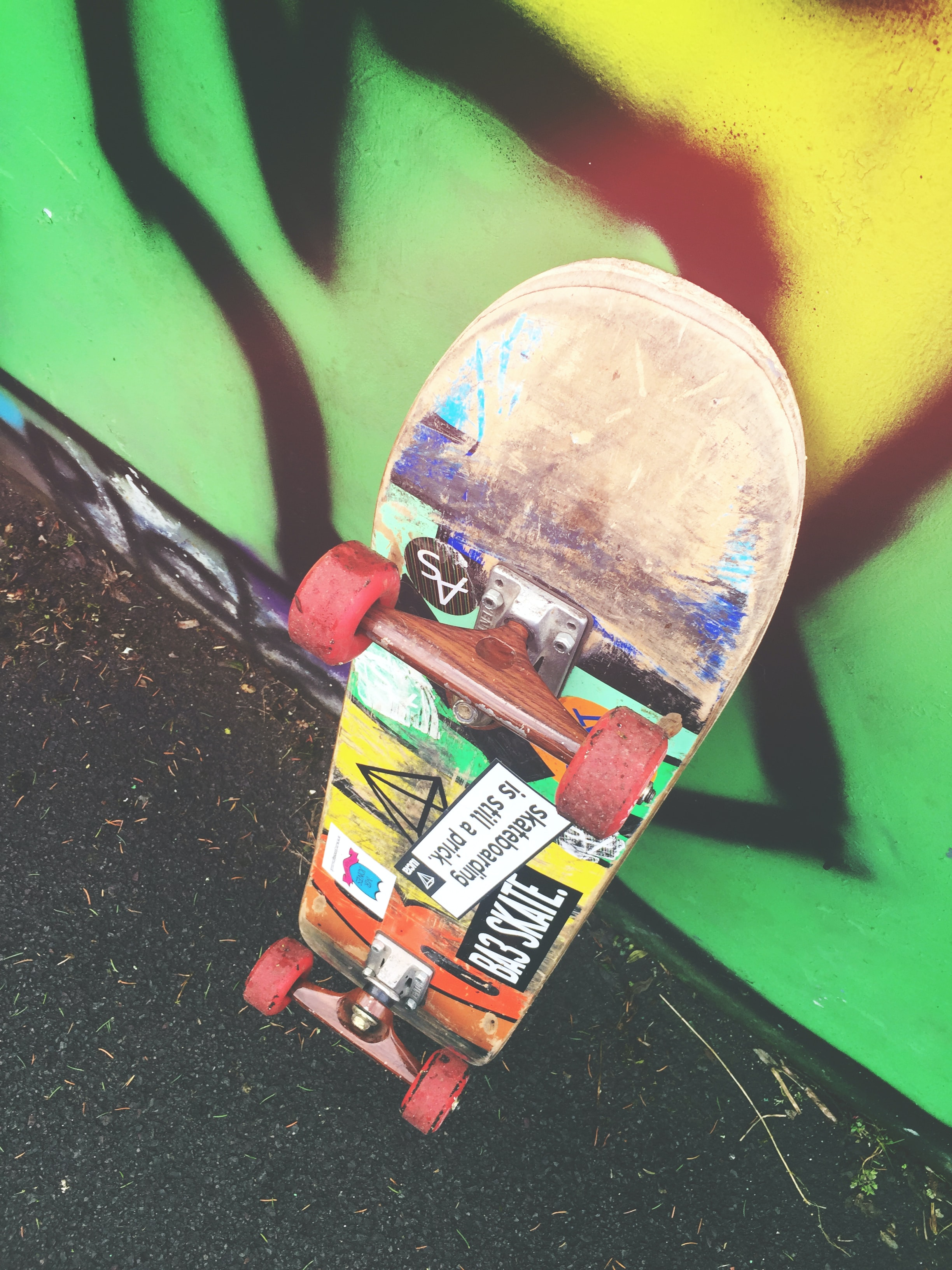 skateboard on graffiti wall