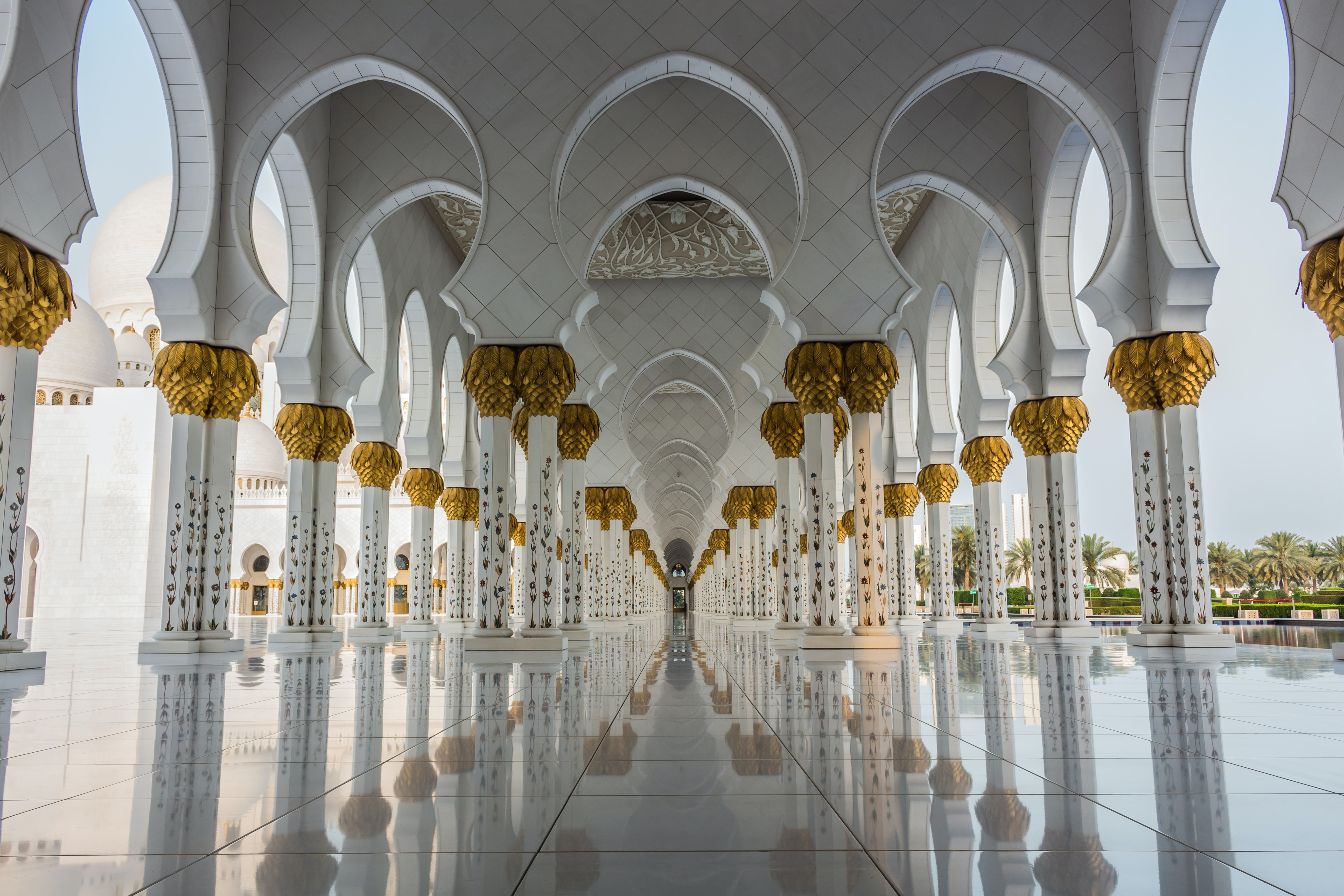 tile flooring between white pillars