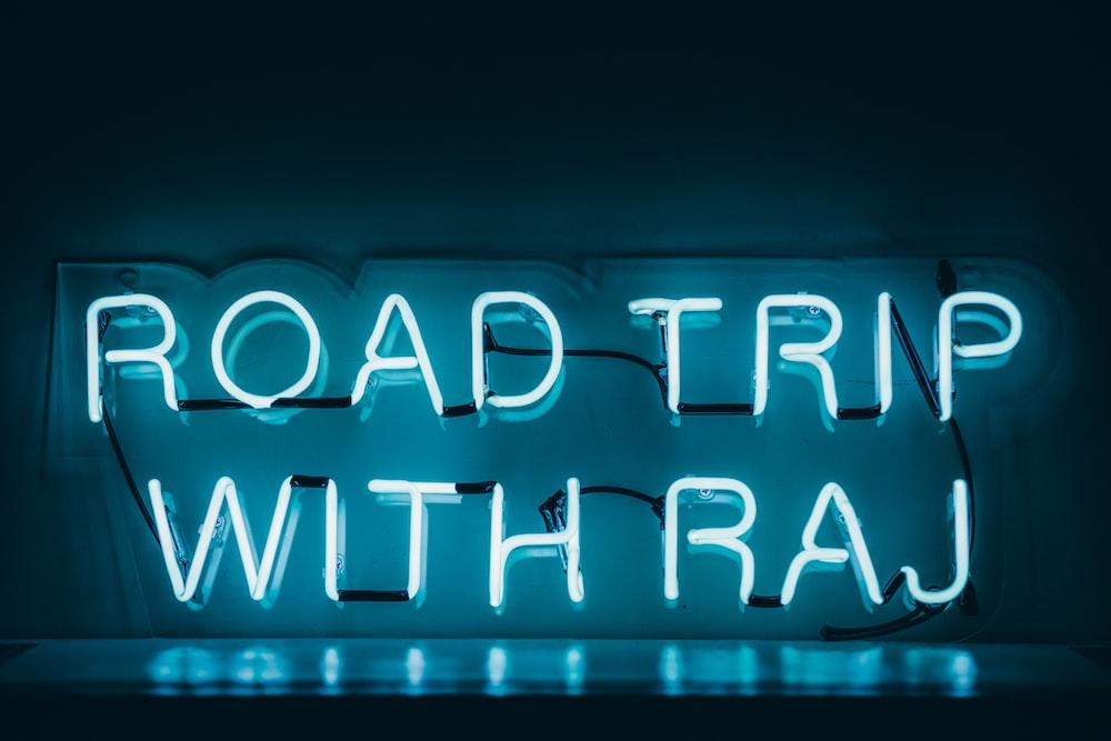 white Road Trip With Raj LED signage