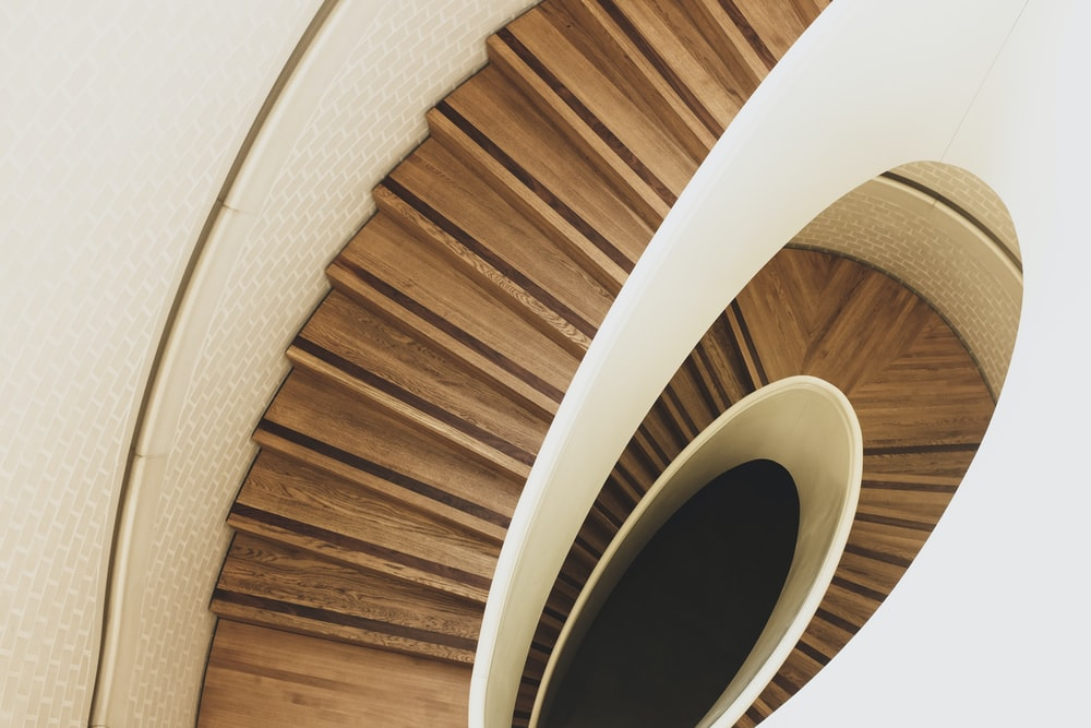 aerial photography of brown spiral stair way