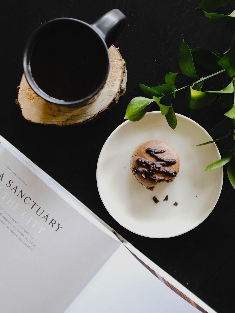 slice muffin near on coffee mug