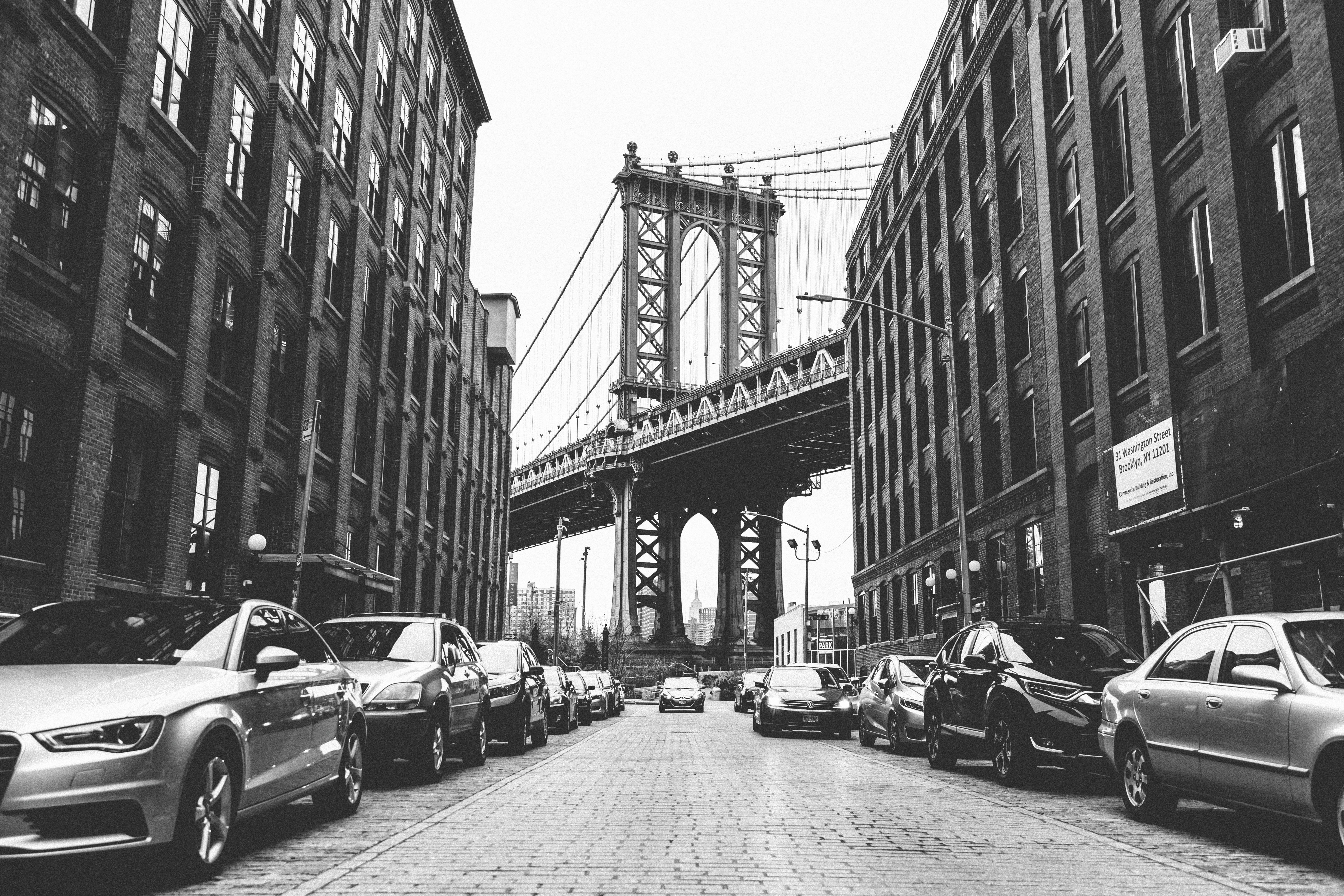 grayscale photography of vehicles in city