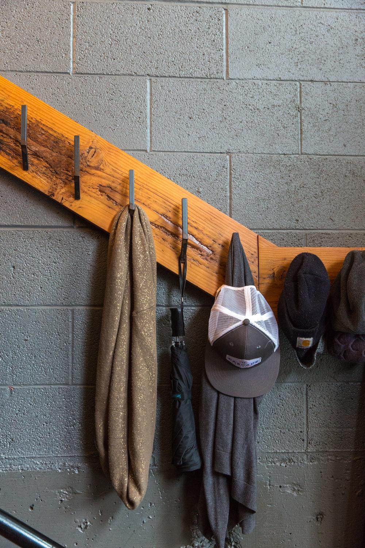 brown scarf hanging on brown rack