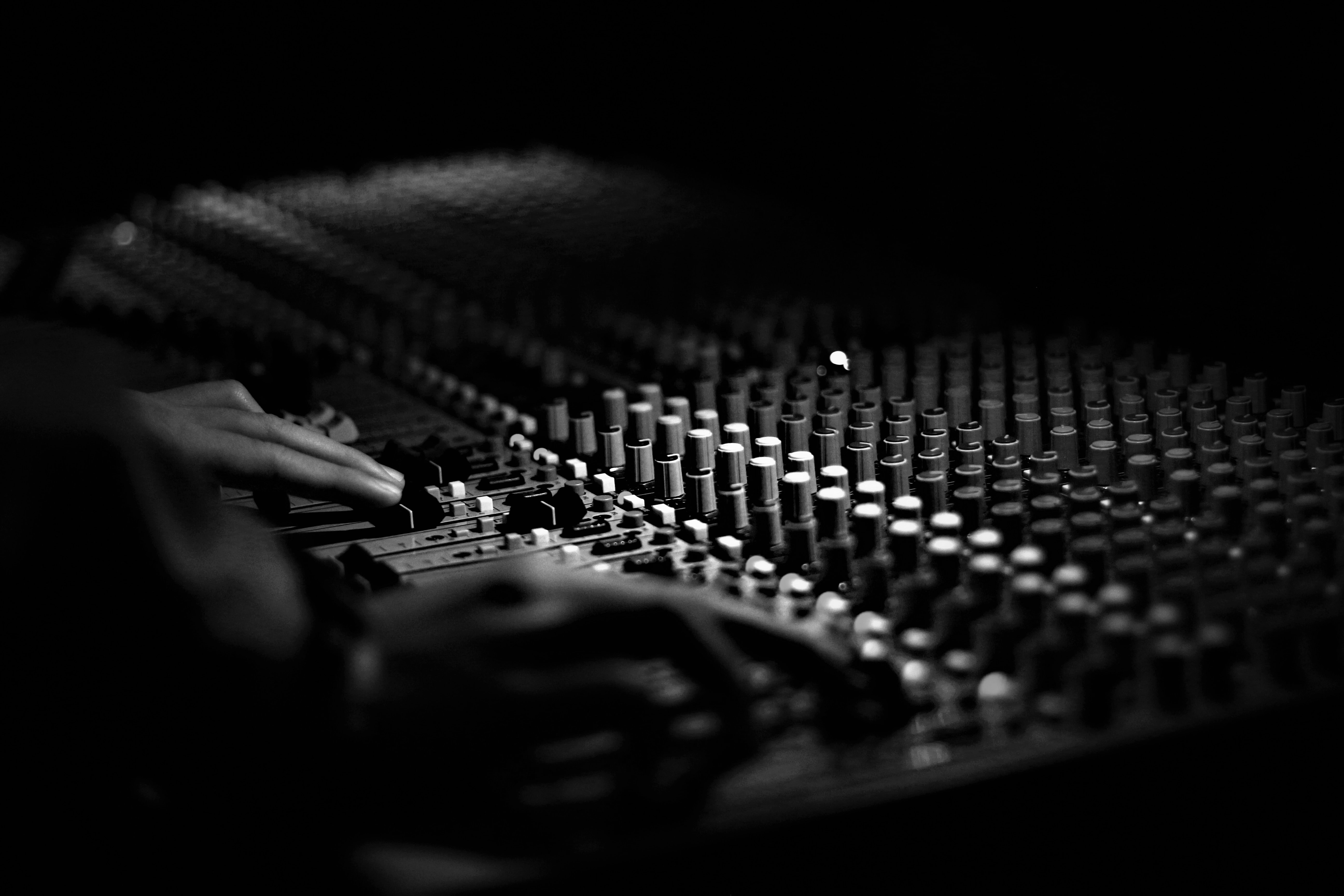 grayscale photography of mixing console