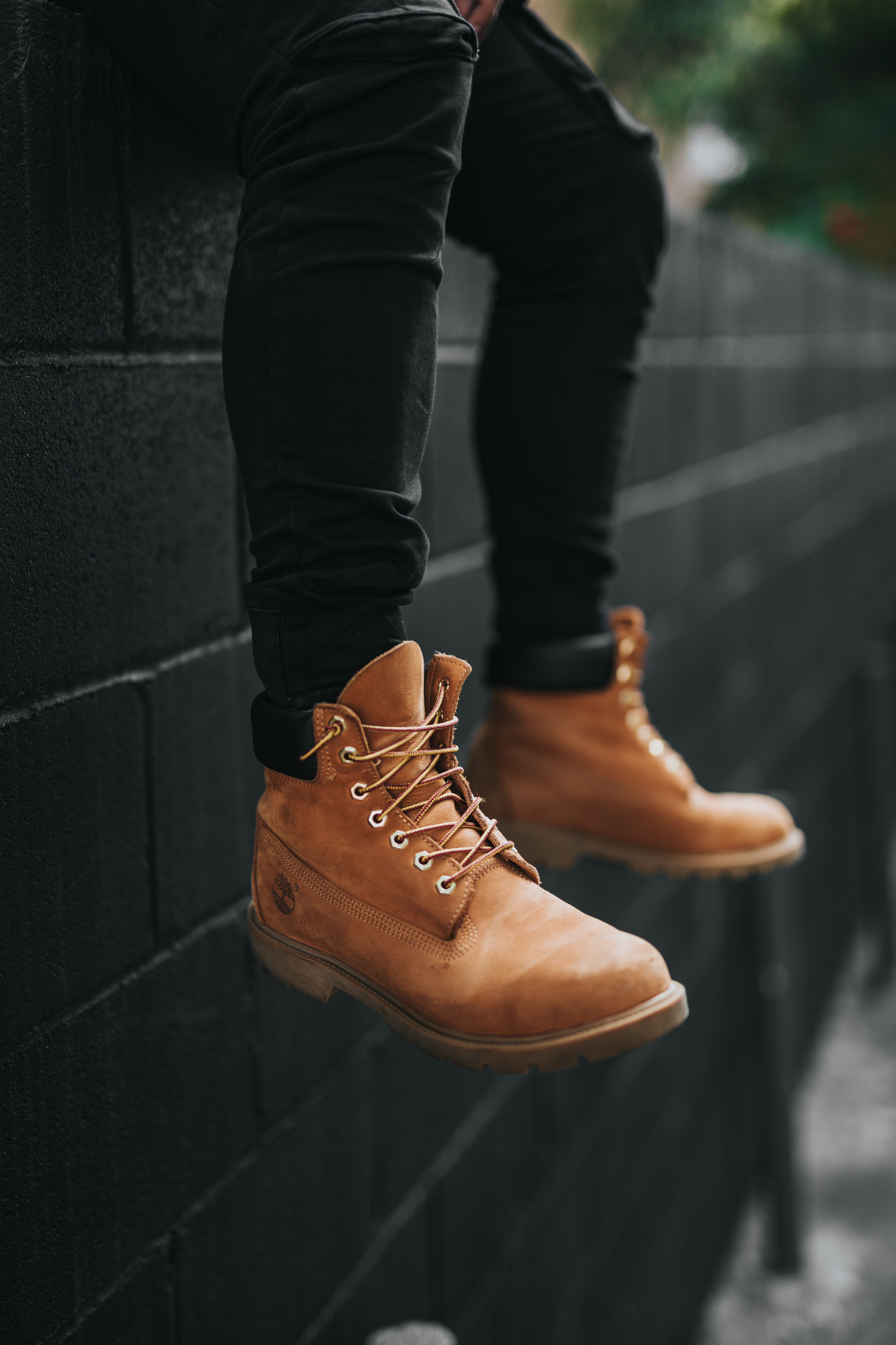 person wearing pair of brown Timberland leather work boots