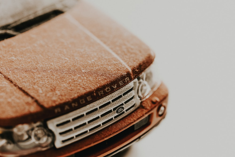 close up photo of brown Land Rover Range Rover die-cast model