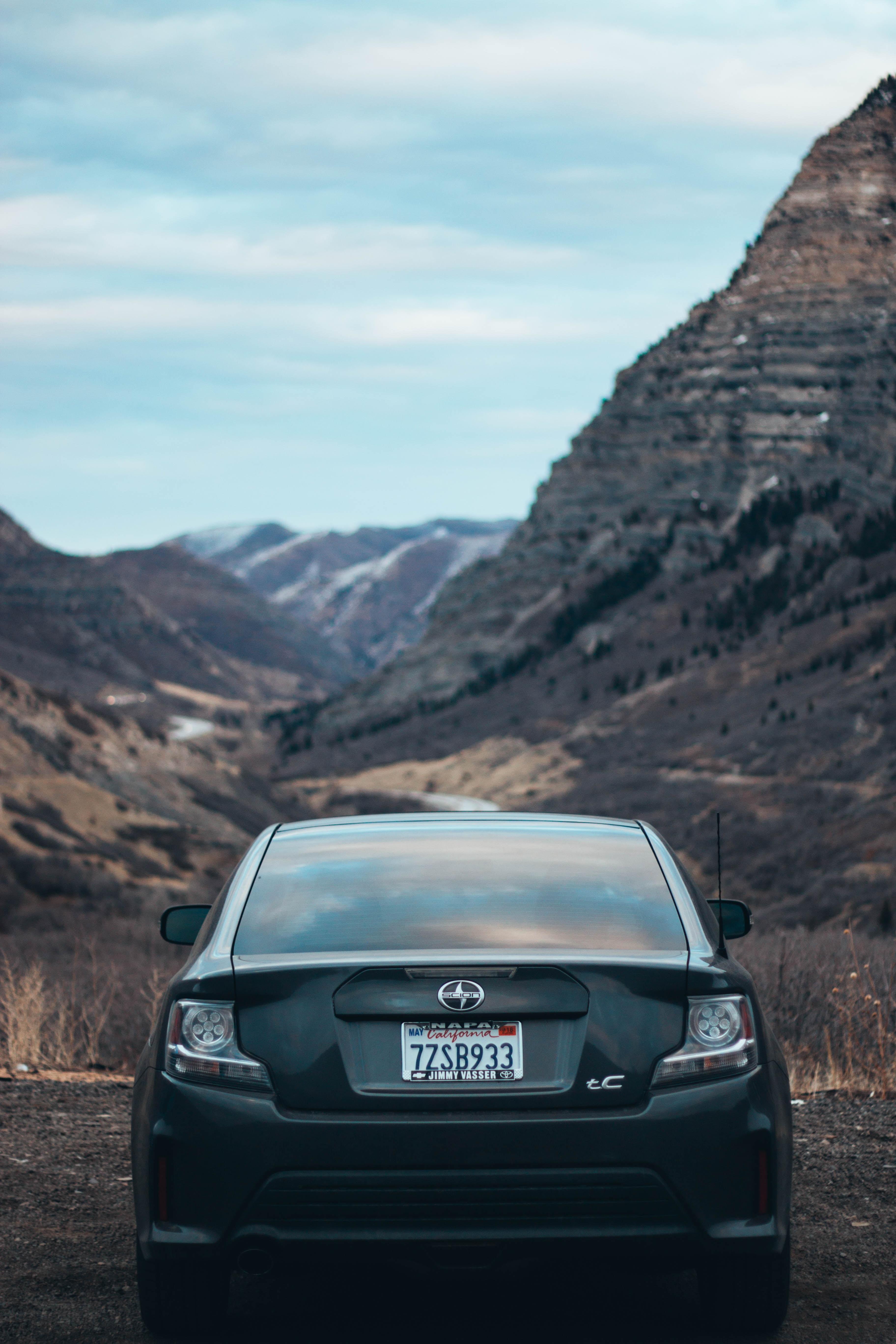 black Scion car parked near mountain range