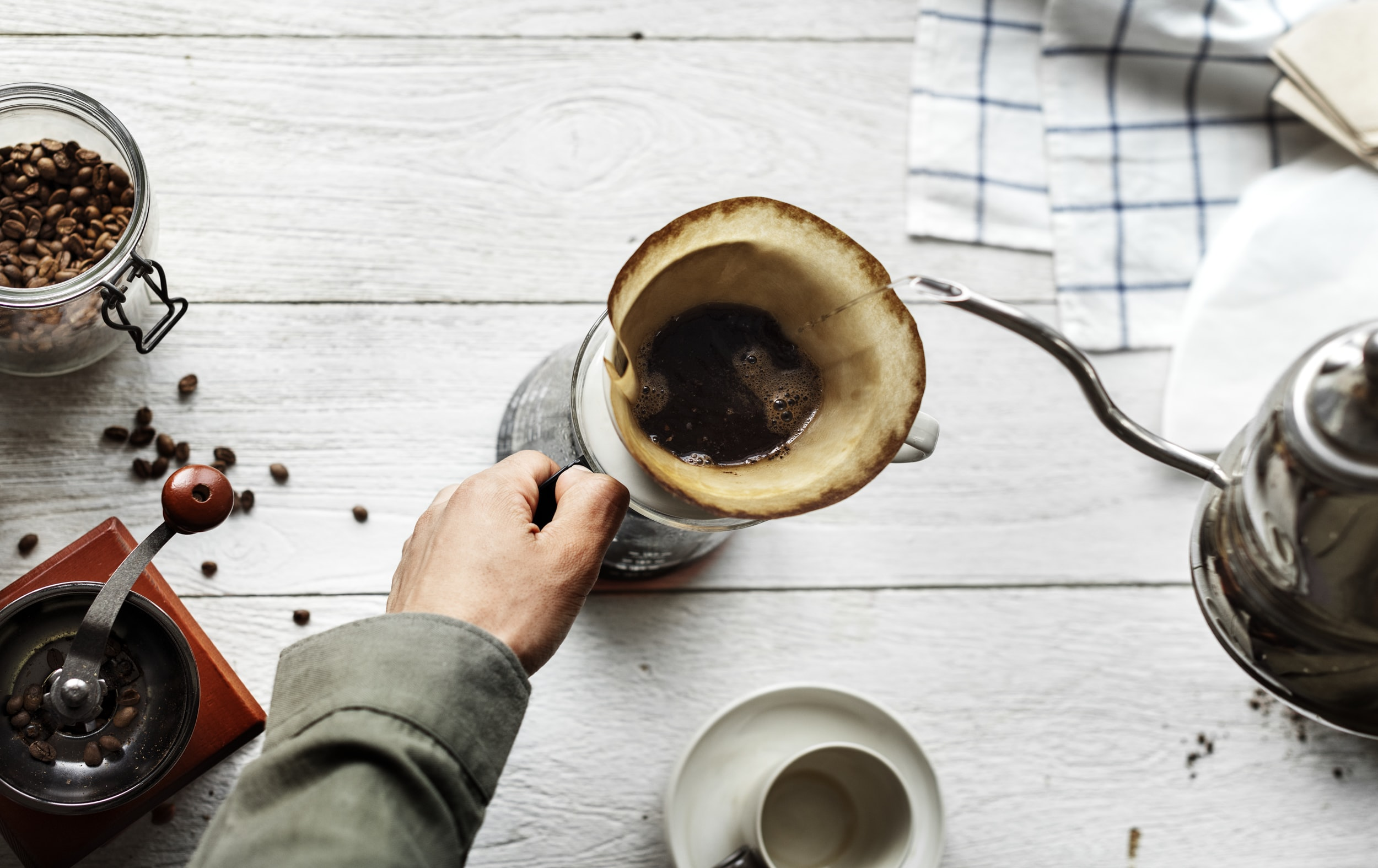 person holding brown mug