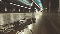 white paper cup spilled on road