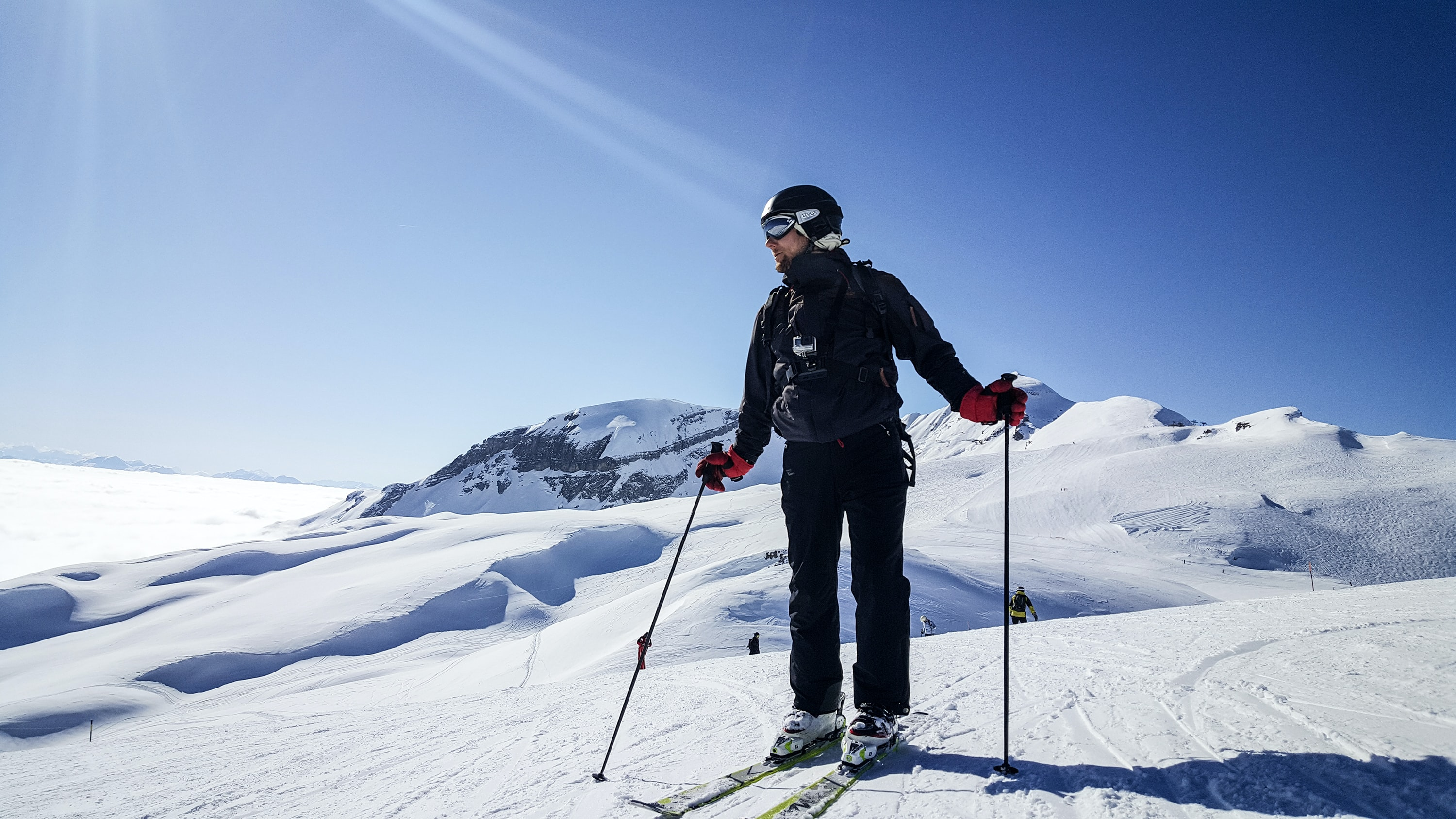 man skiing under clear blue sky