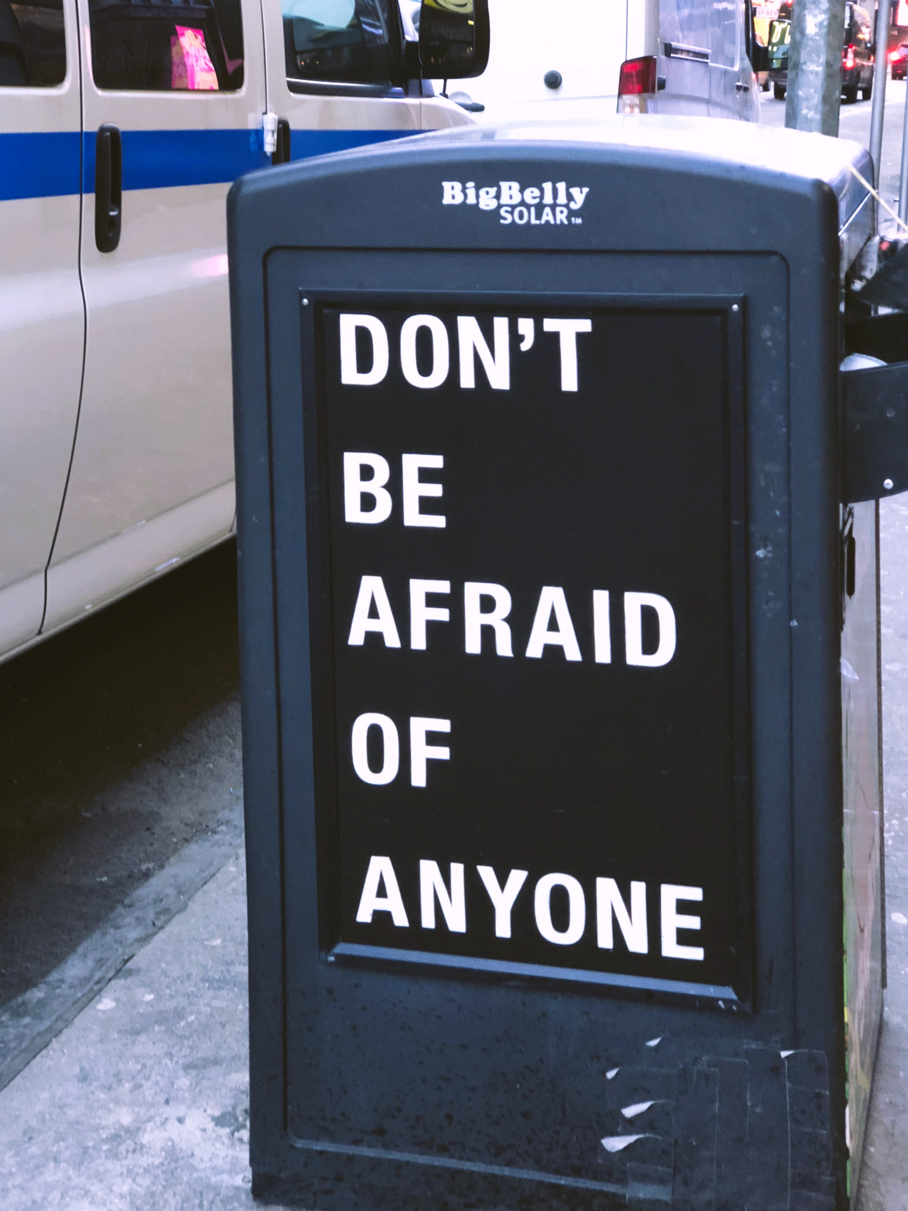 Don't be afraid of anyone sign near vehicle during daytime