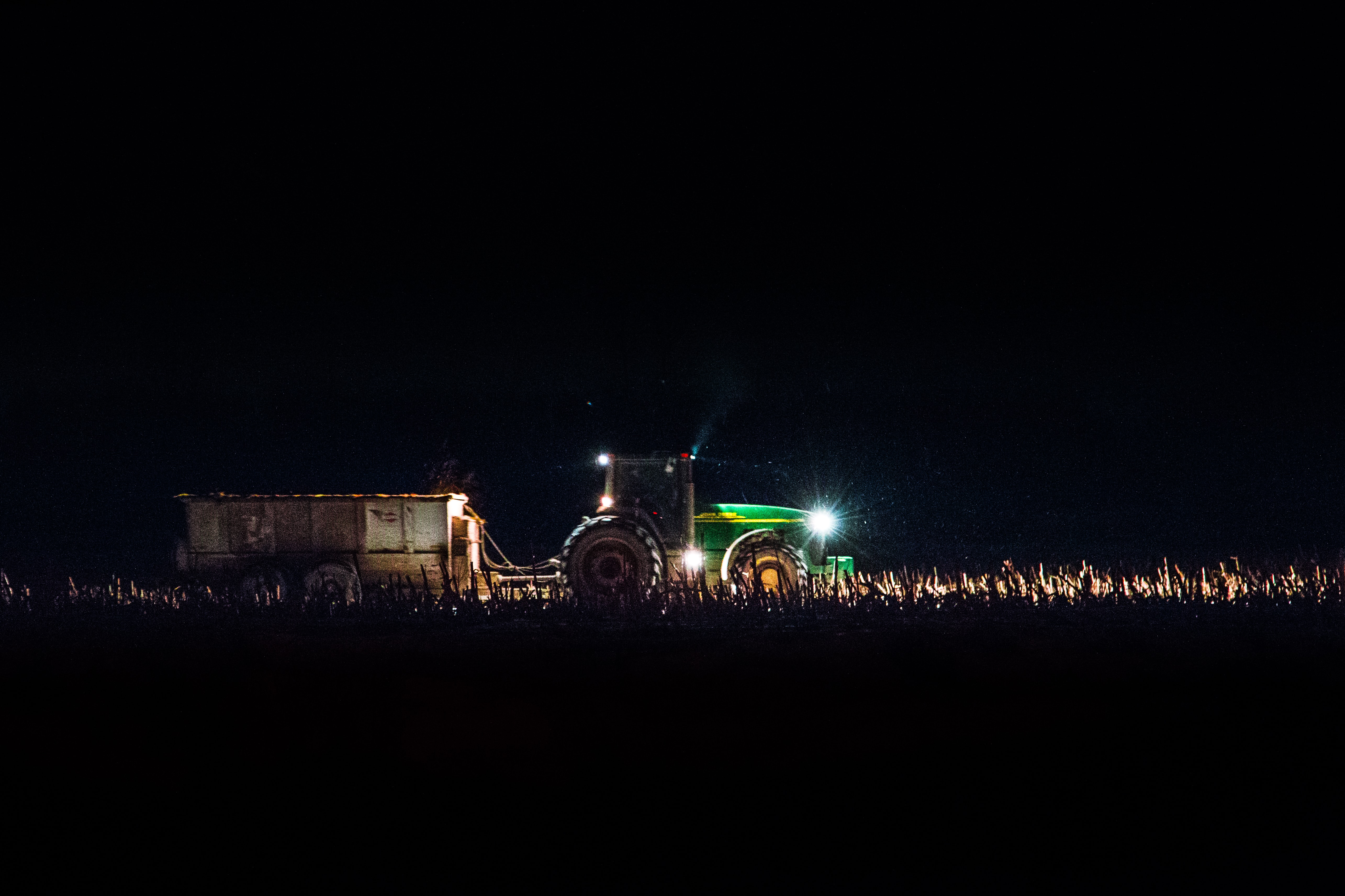 green freight truck on land during night
