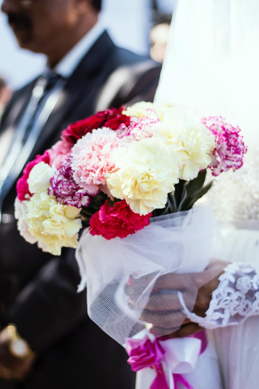 Flower bouquet holding and wedding hd photo by benita elizabeth selective focus photography of flower arrangement izmirmasajfo