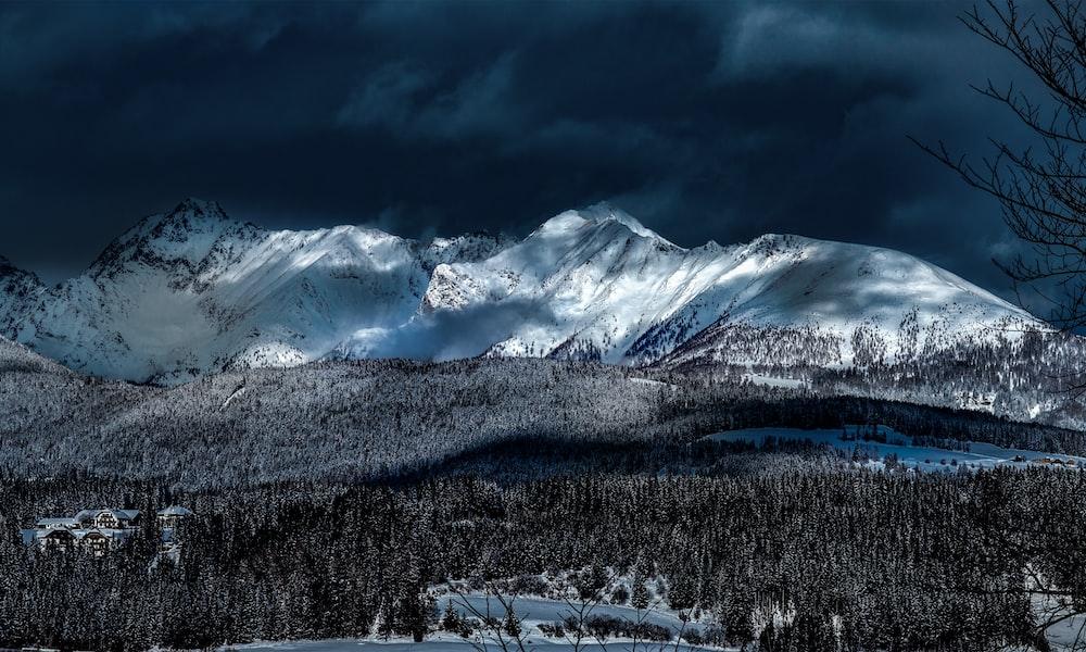 snow covered mountain taken at daytime