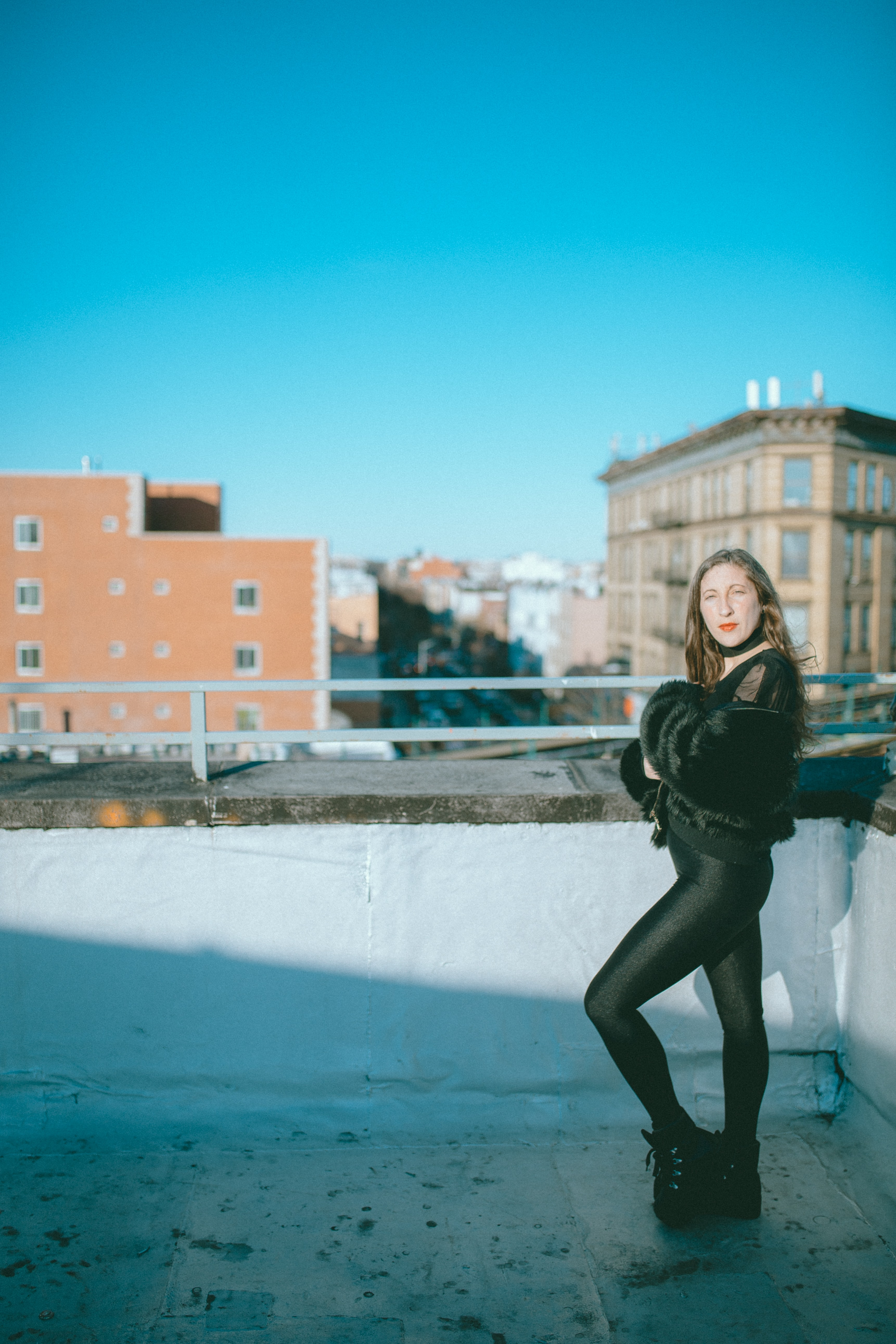 selective focus photography of woman on rooftop