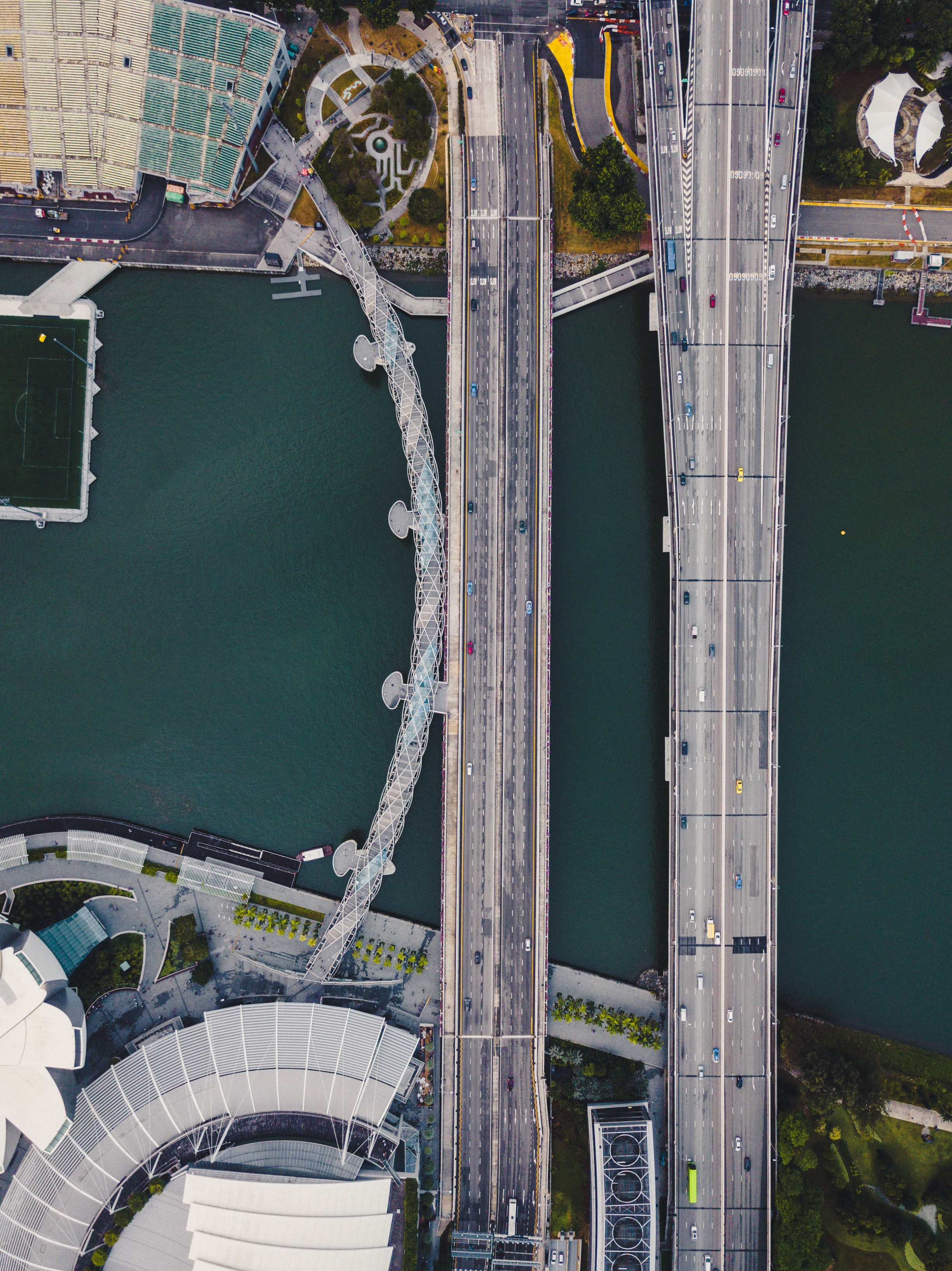 aerial photography of two gray suspension bridge and buildings during daytime