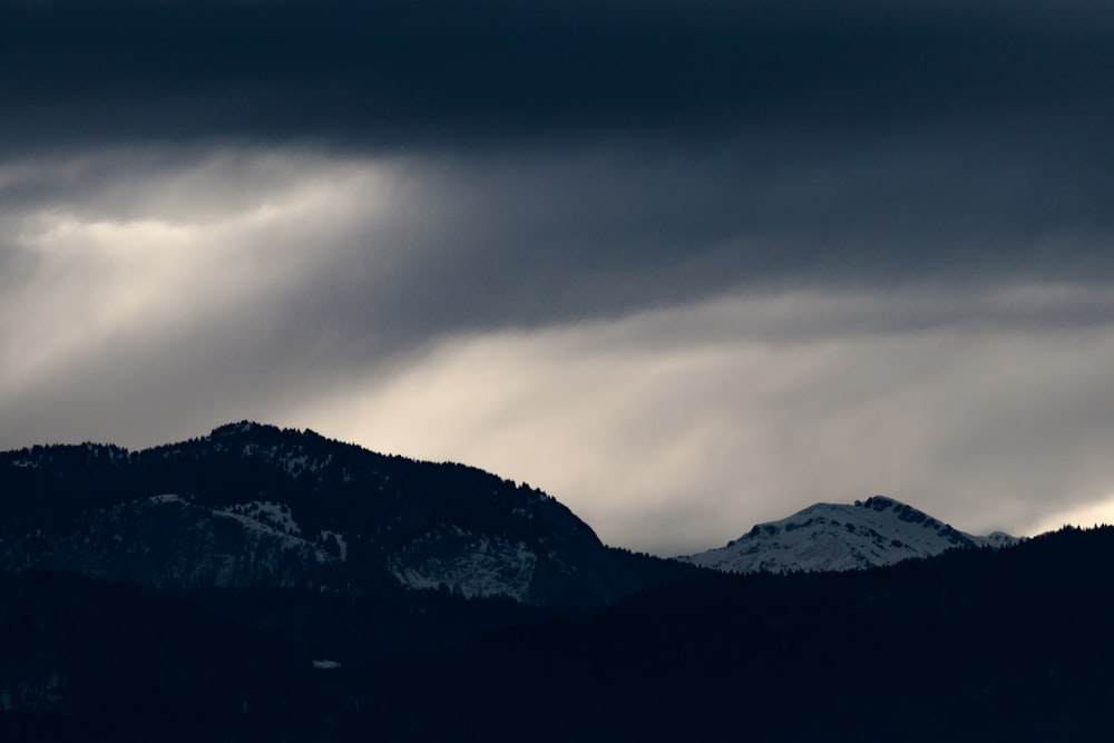 landscape photography of mountain under cloudy sky during daytime