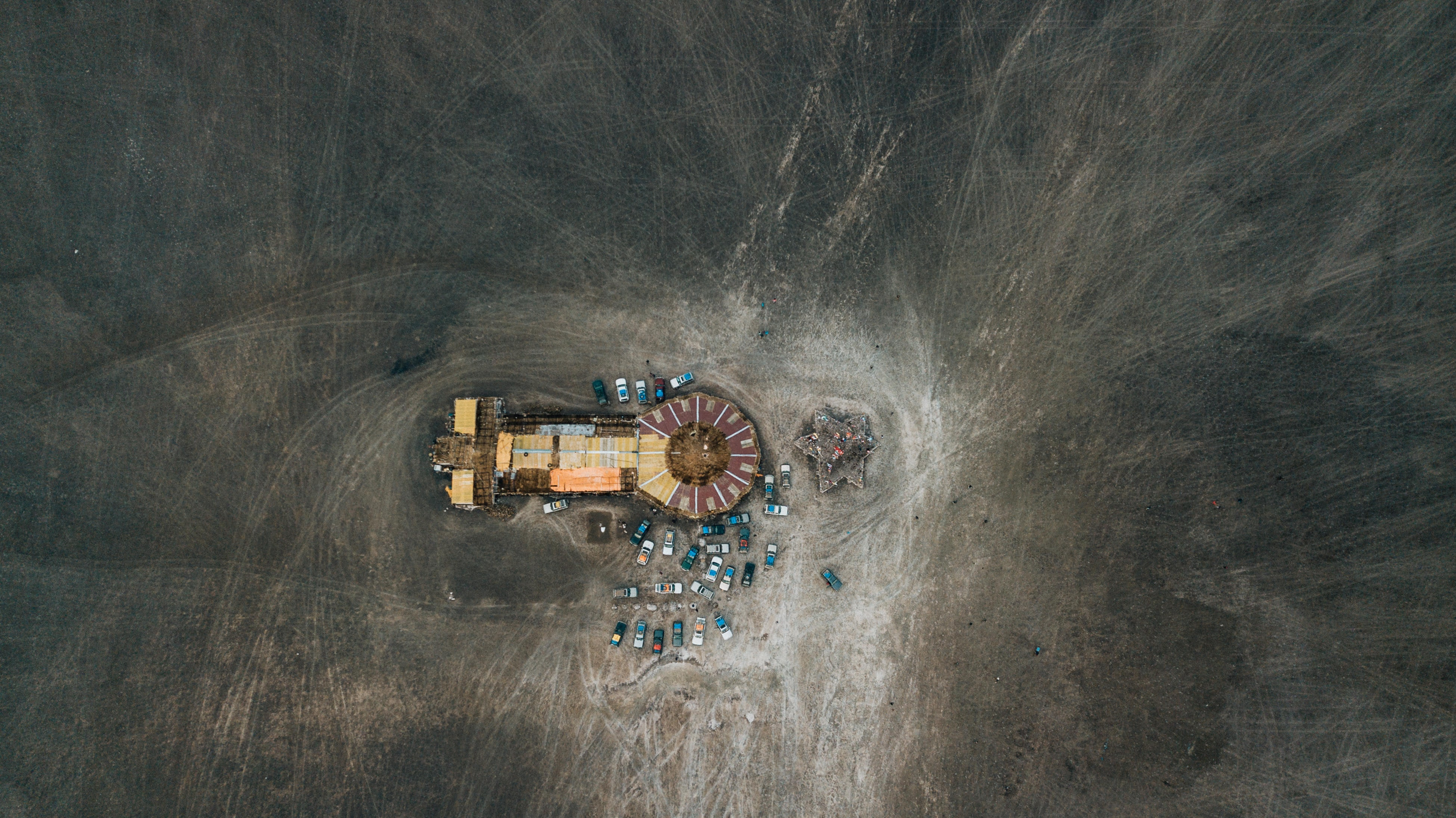 aerial photography of building and vehicles