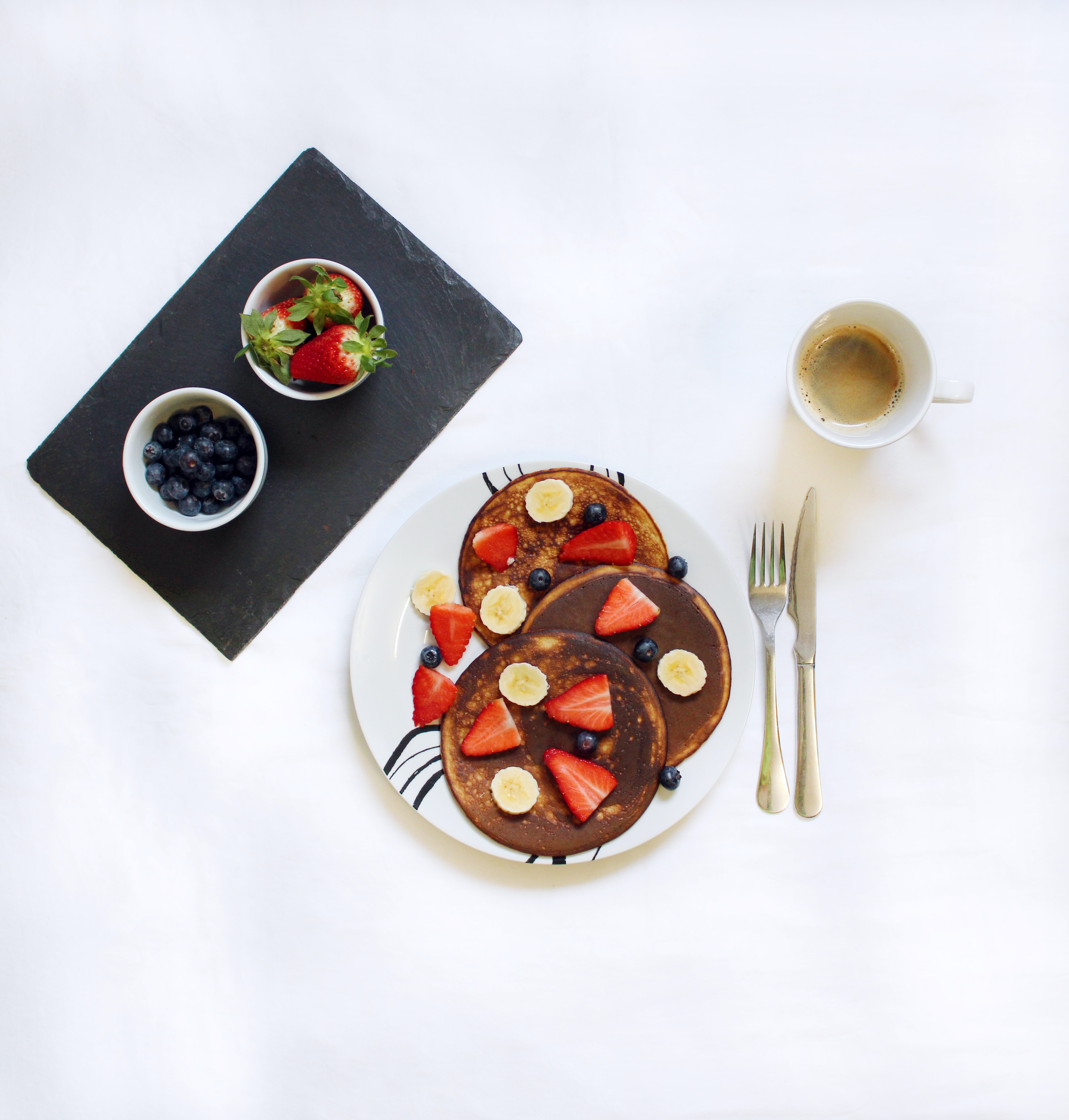 flat-lay photograph of pancakes and coffee in mug