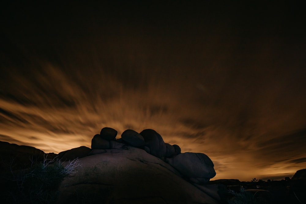 gray rocks under sunset